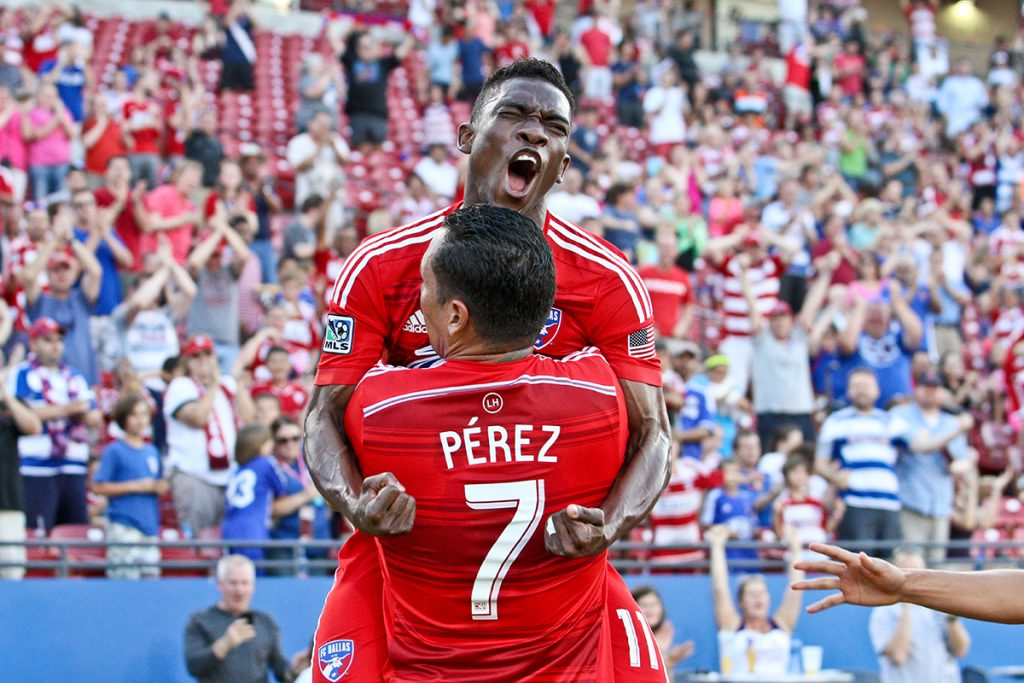 Blas Perez #7 celebrates with Fabian Castillo