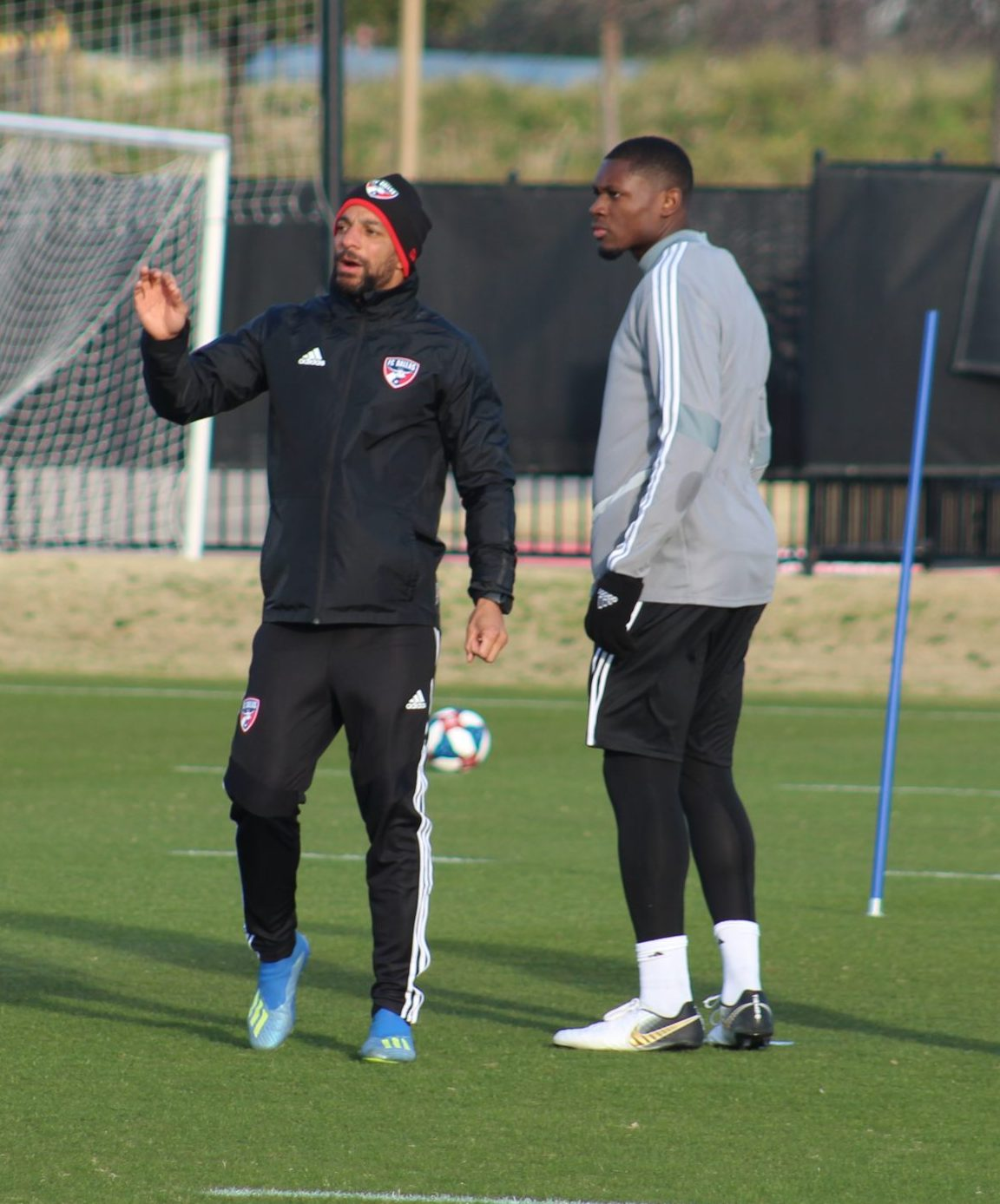FC Dallas Assistant Coach Peter Luccin (L) gives instructions with 2019 SuperDraft pick Eduvie Ikoba stood close by (Dan Crooke / 3rd Degree)