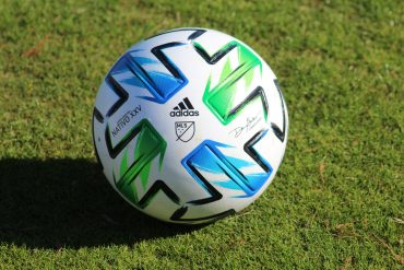 The official match ball for the 25th MLS season - adidas Nativo XXV - sits on a practice field during the opening session of the FC Dallas preseason (Dan Crooke)
